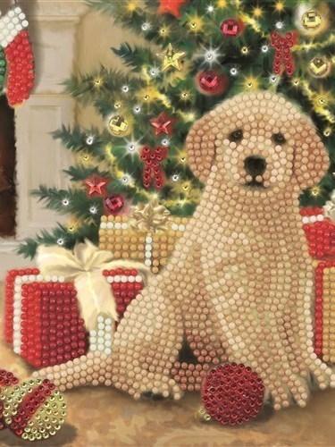 Hondje aan de kerstboom